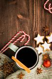 Winter theme. Hot steaming cup of glint wine with spices. Christmas hot steaming cup of glint wine with spices, cinnamon, anise, cookies in a shape of star, red stock photos