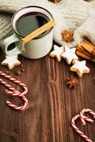 Winter theme. Hot steaming cup of glint wine with spices. Christmas hot steaming cup of glint wine with spices, cinnamon, anise, cookies in a shape of star, red stock images