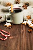 Winter theme. Hot steaming cup of glint wine with spices. Winter and New Year theme. Christmas hot steaming cup of glint wine with spices, cinnamon, anise royalty free stock photos