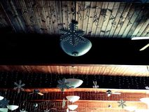Winter themed decorations on a wood ceiling Stock Photography