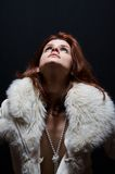 Winter time 02. Girl with fur coat and pearls Royalty Free Stock Photo