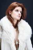 Winter time. Girl with fur coat and pearls stock photo