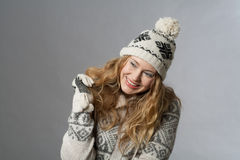 Winter time. Young woman with hat and gloves Stock Photography