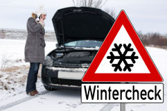 Winter Time. Car break - woman phoned the breakdown service Royalty Free Stock Images