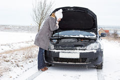 Winter Time. Car break - woman phoned the breakdown service Stock Photography