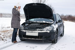 Winter Time. Car break - woman phoned the breakdown service Royalty Free Stock Photography