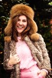 Close-up portrait of happy girl in woolen sweater enjoying winter moments stock photography