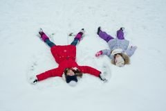 Winter time, children having fun in the snow, top view Stock Images