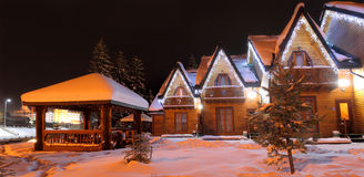 Winter time christmas landscape. The residential house with christmas lights Royalty Free Stock Photo