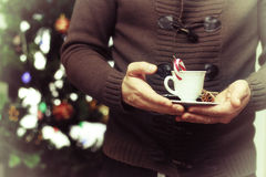 Winter time coffe cup in hand Stock Images