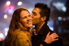 Winter time - couple in street Stock Images