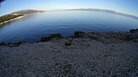 Winter time. Desert rocky Mediterranean  beach in cold winter morning Stock Photography