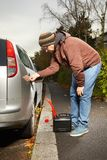 Winter time dressed man filling tank of car Stock Images