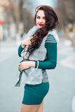 Winter time fashion for women. Woman wearing sweater fur vest belt and pendant in freezing cold time. Stock Image