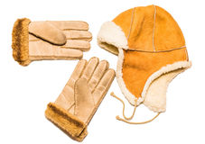 Winter time. Gloves and winter cap on white background Stock Photos