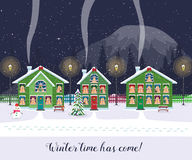 Winter time has come. Postcard with pretty houses in the snow. Decorated Christmas elements. Stock Image