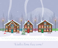 Winter time has come. Postcard with pretty houses in the snow. Decorated Christmas elements. Royalty Free Stock Photography