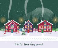 Winter time has come. Postcard with pretty houses in the snow. Decorated Christmas elements. Stock Photos