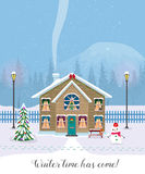 Winter time has come. Postcard with pretty houses in the snow. Decorated Christmas elements. Stock Photo