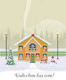 Winter time has come. Postcard with pretty houses in the snow. Decorated Christmas elements. Royalty Free Stock Images