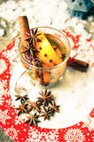 Winter time: hot wine with spices Royalty Free Stock Photos
