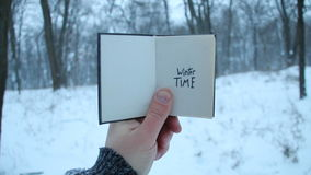 Winter time idea. Book and text. Winter time. Hand holding a book with the inscription stock footage
