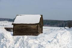 Winter time. Image of log house in village Stock Photo