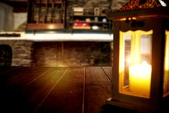 Free Winter Time, Moody Burning Lantern On Wooden Table. Space For Your Text Or Decoration. Old Fireplace Wall Background. Stock Images - 163977514
