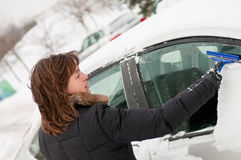 Winter time - person cleaning car Royalty Free Stock Photo