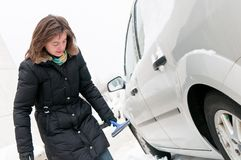 Winter time - person cleaning car Stock Images