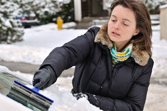 Winter time - person cleaning car Royalty Free Stock Image