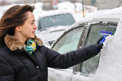 Winter time - person cleaning car Royalty Free Stock Photos