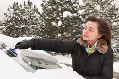 Winter time - person cleaning car Stock Image