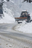 Winter time road with a snowplow Stock Images