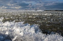 Winter time sea is freezing up and the ice is pushing through closer to the coast line royalty free stock photography