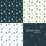 Winter time - set of seamless winter backgrounds. Dark and light winter backgrounds - trees and snowfall Royalty Free Stock Photos