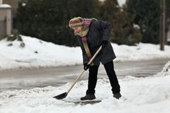 Winter time, snow removing from street Stock Image