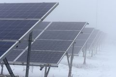 Winter time and solar collectors in fog Stock Photography