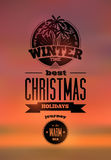 Winter time. Typographic retro Christmas design on blurry sunset background. Vector illustration. Eps 10. Royalty Free Stock Photos