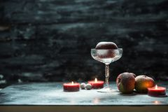 Winter time, winter red apple and candles in a snow royalty free stock photography