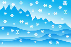 Winter times. Mountains in blue  a snow flakes Stock Photo