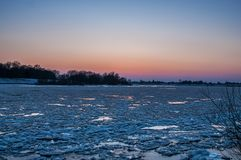 Sunset view, Ice floes on the german river elbe in Geesthacht, near Hamburg stock photo