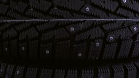 Winter tire on the background of racks with tires stock video