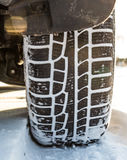 Winter tire on car, close-up. Royalty Free Stock Images