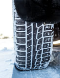 Winter tire on car, close-up. royalty free stock photos