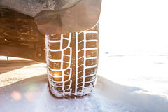 Winter tire on car, close-up. Royalty Free Stock Photo
