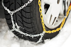 Winter tire in chains Royalty Free Stock Photography