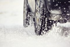 Winter tire. Detail of the tire on winter road Royalty Free Stock Image