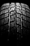 Winter tire isolated on black Royalty Free Stock Photography