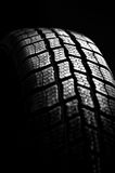 Winter tire isolated on black Royalty Free Stock Images
